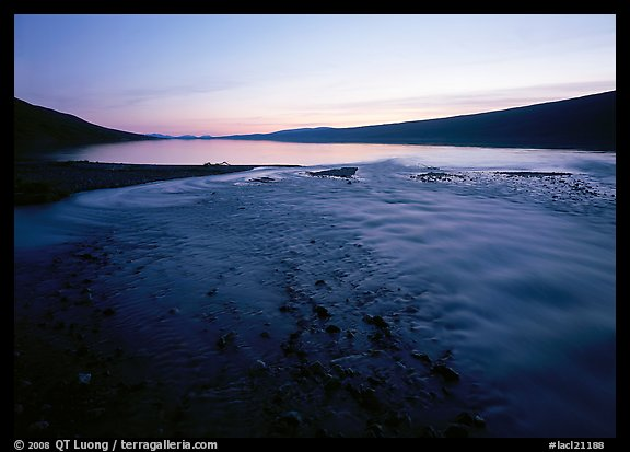 Stream flows into Turquoise Lake, midnight sunset. Lake Clark National Park, Alaska, USA.