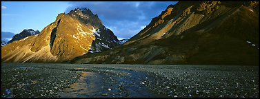 Stream, gravel bar, and mountains at sunset. Lake Clark National Park (Panoramic color)