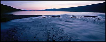 Wide stream flowing into lake at sunset. Lake Clark National Park (Panoramic color)