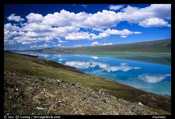 Turquoise Lake and clouds. Lake Clark National Park, Alaska, USA.