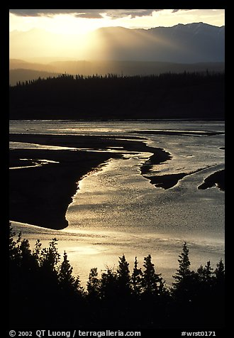 Early morning sun shining on the wide Chitina river. Wrangell-St Elias National Park, Alaska, USA.