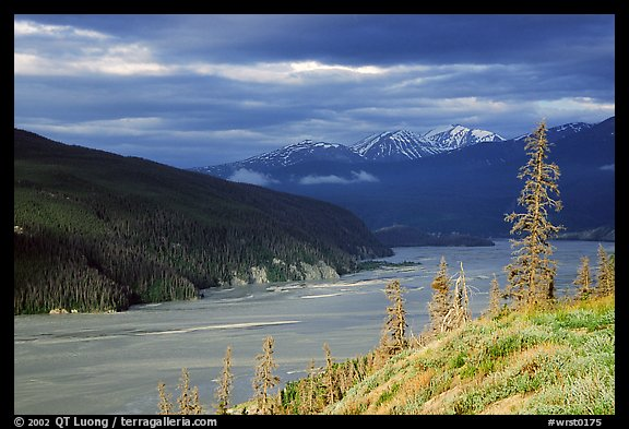 Chitina river valley, snowy peaks, and storm light. Wrangell-St Elias National Park, Alaska, USA.