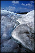 Ice, glacial creek on Root glacier, and mountains. Wrangell-St Elias National Park, Alaska, USA. (color)