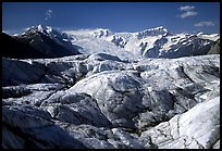 Crevasses on Root glacier, Wrangell mountains in the background. Wrangell-St Elias National Park, Alaska, USA.