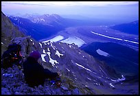 Mountaineer looking down from Mt Donoho. Wrangell-St Elias National Park, Alaska, USA. (color)