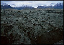 Glacier covered with black rocks. Wrangell-St Elias National Park, Alaska, USA.