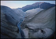 Root Glacier, glacial stream, and mountains at dusk. Wrangell-St Elias National Park, Alaska, USA. (color)