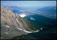View over hazy Chugach mountains and Kennicott Glacier from Mt Donoho. Wrangell-St Elias National Park, Alaska, USA.
