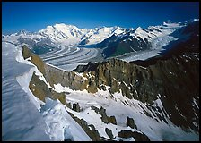 Corniche and view of glaciers and Mt Blackburn range. Wrangell-St Elias National Park, Alaska, USA.