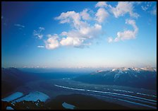 Kennicott Glacier, Chugach mountains, and clouds from Mt Donoho, sunrise. Wrangell-St Elias National Park, Alaska, USA.