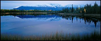 Pond and reflected mountains at dusk. Wrangell-St Elias National Park (Panoramic color)