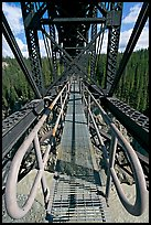 Foot catwalk below the Kuskulana river bridge. Wrangell-St Elias National Park, Alaska, USA. (color)