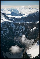 Aerial view of steep rock mountain faces. Wrangell-St Elias National Park, Alaska, USA. (color)