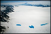 Aerial view of Bagley Field with turquoise snow melt lakes. Wrangell-St Elias National Park, Alaska, USA.