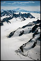 Aerial view of mountains with Mt St Elias in background. Wrangell-St Elias National Park, Alaska, USA. (color)