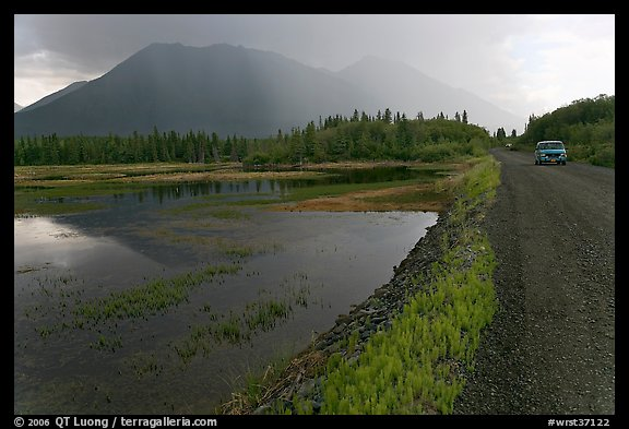 McCarthy Road and lake during afternoon storm. Wrangell-St Elias National Park, Alaska, USA.