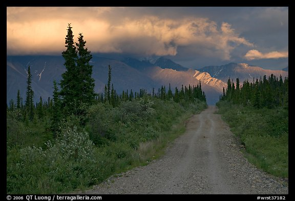 Nabena road at sunset with last light on mountains. Wrangell-St Elias National Park, Alaska, USA.