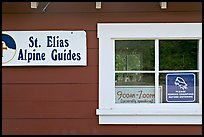Mountain guide office with interesting signs. Wrangell-St Elias National Park, Alaska, USA. (color)