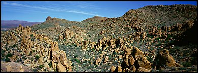 Valley strewn with rock boulders, Grapevine Mountains. Big Bend National Park (Panoramic color)