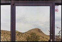 Santiago mountains, Persimmon Gap Visitor Center window reflexion. Big Bend National Park, Texas, USA. (color)