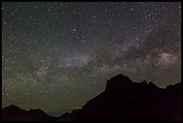 Starry sky and Milky Way above Chisos Mountains. Big Bend National Park, Texas, USA. (color)