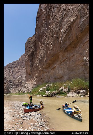 Canoeists bellow steep walls of Boquillas Canyon. Big Bend National Park (color)
