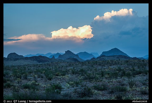 Dark desert landscape with last light falling on clouds. Big Bend National Park (color)
