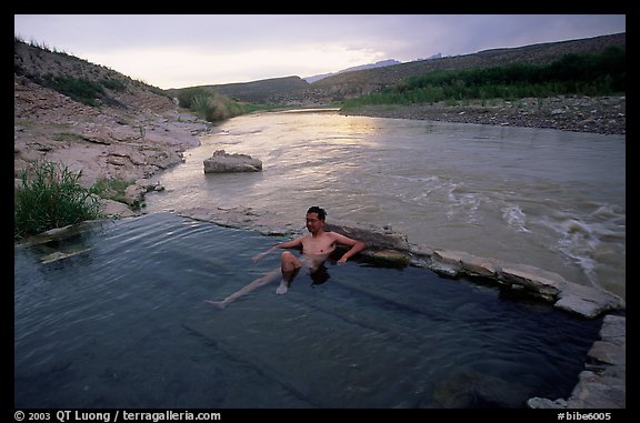 Visitor relaxes in hot springs next to Rio Grande. Big Bend National Park, Texas, USA.