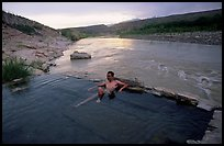 Visitor relaxes in hot springs next to Rio Grande. Big Bend National Park ( color)