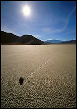 Tracks and moving rock on the Racetrack, mid-day. Death Valley National Park, California, USA. (color)