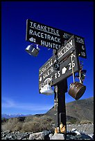 Tea kettle Junction sign, adorned with tea kettles. Death Valley National Park, California, USA.