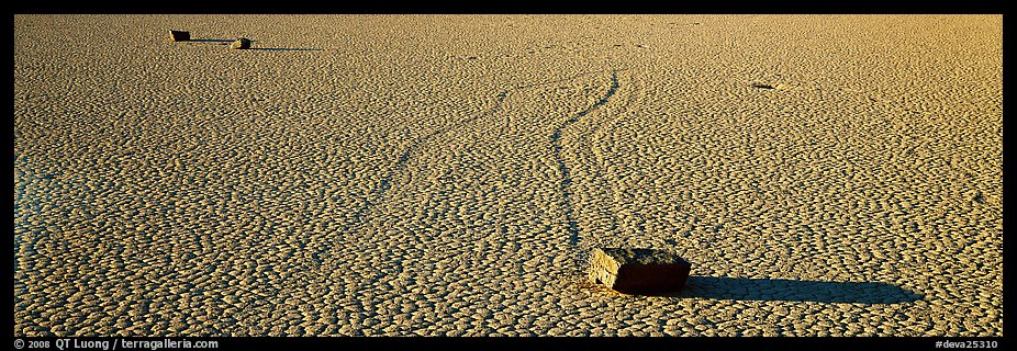 Moving stones on dried mud playa. Death Valley National Park (color)