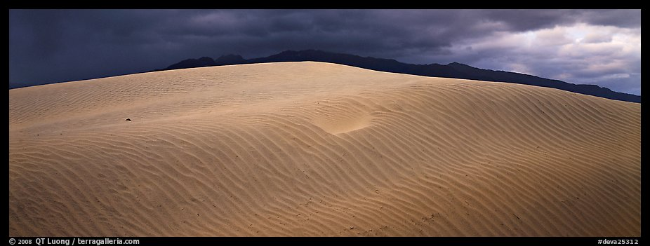 Dune and mountain in stormy weather. Death Valley National Park (color)