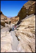 Hikers in narrows, Mosaic canyon. Death Valley National Park, California, USA. (color)