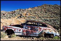 Car with bullet holes near Aguereberry camp, afternoon. Death Valley National Park, California, USA.