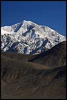 Telescope peak rising above sage-covered hills. Death Valley National Park, California, USA.