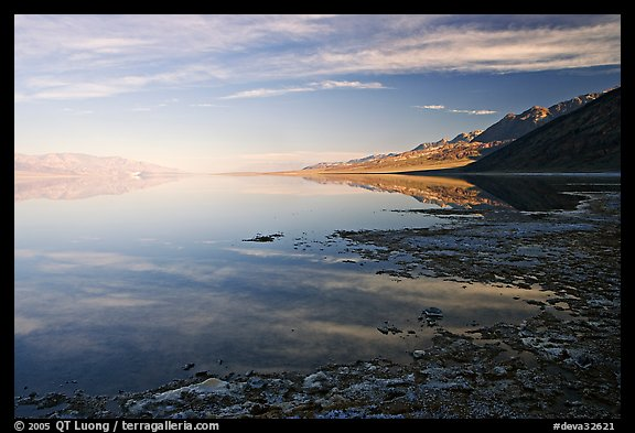Flooded Badwater basin and Black mountain reflections, early morning. Death Valley National Park, California, USA.