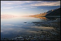 Flooded Badwater basin and Black mountain reflections, early morning. Death Valley National Park, California, USA. (color)