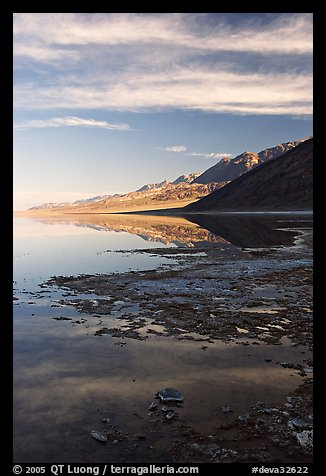 Black mountain reflections in flooded Badwater basin, early morning. Death Valley National Park (color)