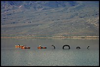 Kayakers approaching the dragon in the rare Manly Lake. Death Valley National Park, California, USA.