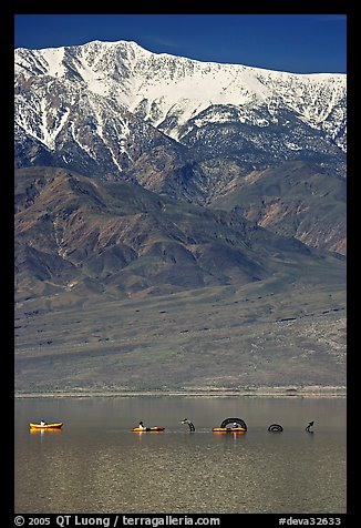Kayakers near the Loch Ness Monster in Manly Lake, below Telescope Peak. Death Valley National Park, California, USA.