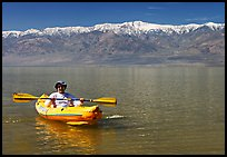 Kayaker padding ephemeral Manly Lake. Death Valley National Park, California, USA. (color)