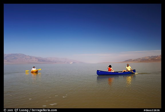 Canoists and kayaker on the flooded floor. Death Valley National Park, California, USA.