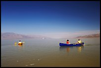 Canoists and kayaker on the flooded floor. Death Valley National Park, California, USA. (color)