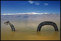 Loch Ness Monster art installation in Manly Lake and Panamint range. Death Valley National Park, California, USA. (color)