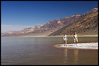 Couple on the shores of Manly Lake. Death Valley National Park, California, USA. (color)