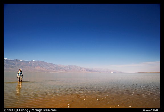 Woman wading in Manly Lake. Death Valley National Park (color)