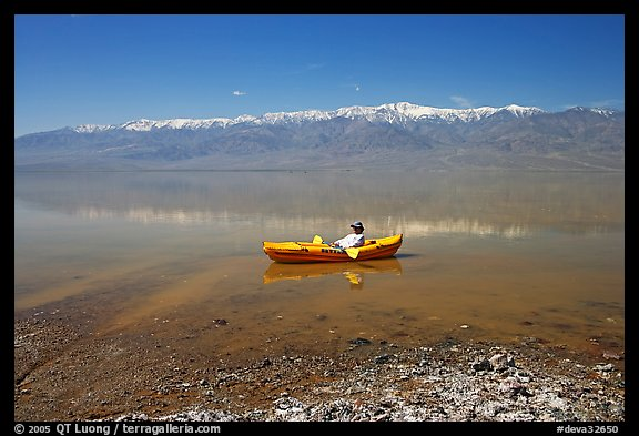 Kayaker near shore in Manly Lake. Death Valley National Park, California, USA.