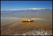 Kayaker near shore in Manly Lake. Death Valley National Park, California, USA. (color)