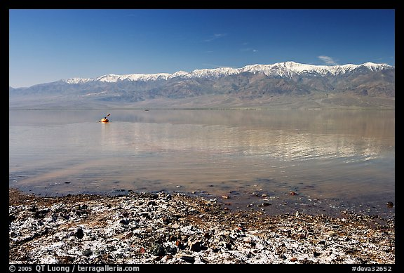 Salt formations, kayaker in a distance, and Panamint range. Death Valley National Park (color)